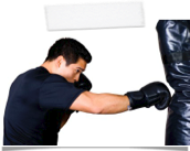man boxing heavy bag