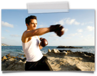 man boxing on beach