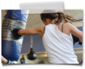 girl boxing heavy bag